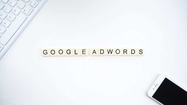 """The phrase """"Google AdWords"""" lined up with letter cubes."""