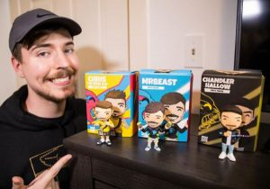 """Jimmy """"MrBeast"""" Donaldson next to his and his two team members' Youtooz figures."""